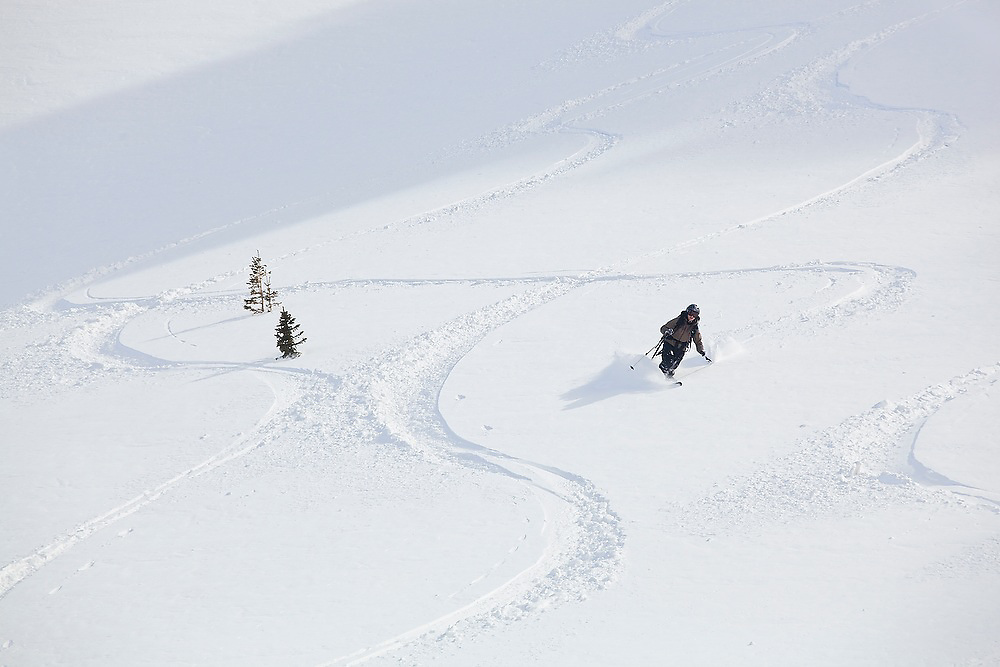 Backcountry skier Meaghan Daly catches turns on the steep open slopes below Hayden Peak, San Juan Mountains, Colorado.