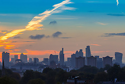 Primrose Hill, London, October 28th 2016. The city's skyscrapers are revealed as dawn breaks over London.