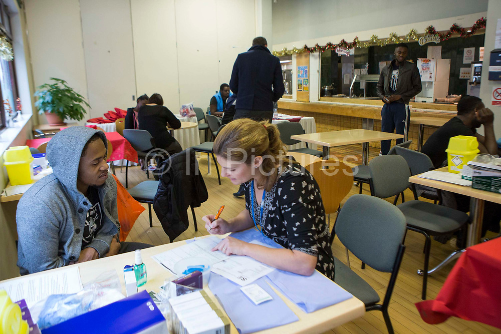 A TB Nurse Specialist Public Health Nurse interviews a patient to identify risk factors for TB exposure during a contact tracing screening exercise in a young people's hostel in central London, UK.