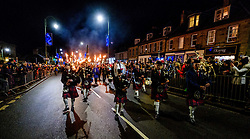 The Biggar Hogmanay bonfire lit at 9.30pm on Hogmanay by local resident Bobby Boyd MBE.  Biggar Pipe Band lead the torchlight procession up the High Street prior to the fire being lit.<br /> <br /> This is probably the biggest new year bonfire anywhere in the UK and continues a tradition going back hundreds of years.<br /> <br /> <br /> (c) Andrew Wilson | Edinburgh Elite media