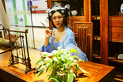 August 3, 2017 - Yichang, Yichang, China - Yichang, CHINA-July 29 2017: (EDITORIAL USE ONLY. CHINA OUT)..A woman in traditional Chinese dress pose for a photo at a traditional Chinese furniture store in Yichang, central China's Hubei Province, July 29th, 2017. (Credit Image: © SIPA Asia via ZUMA Wire)