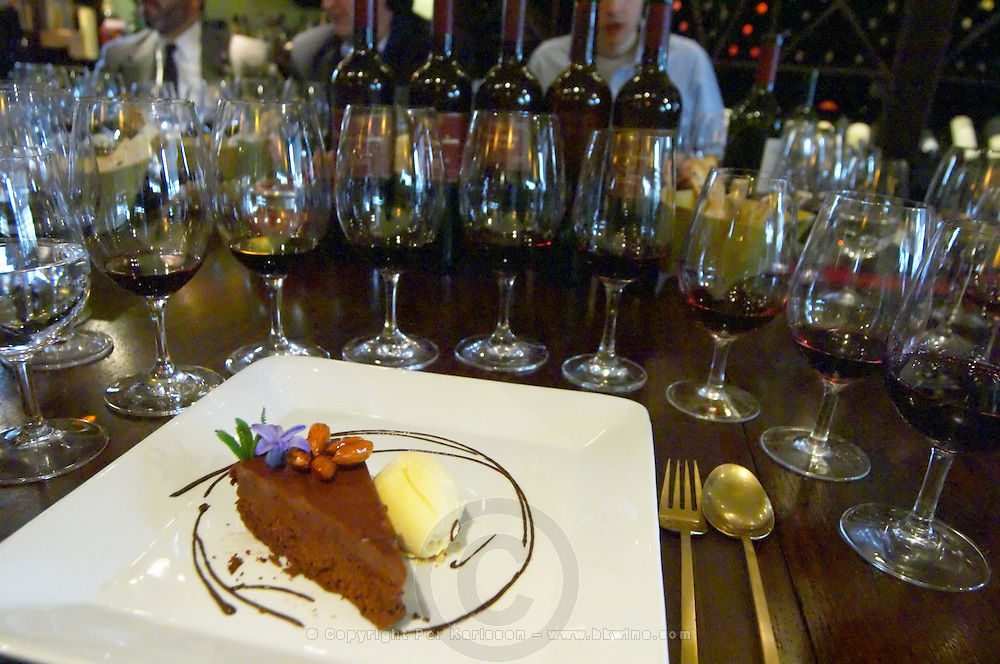 Chocolate cake with almonds and icecream Glasses lined up for a vertical tasting, in the background bottles of Angel A Mendoza Malbec Cabernet Sauvignon Pura Sangre Domaine St Diego Lunlunta Maipu Mendoza The O'Farrell Restaurant, Acassuso, Buenos Aires Argentina, South America