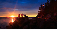 Visitors are treated to a gorgeous sunset at the Bass Harbor Head Light, a classic New England lighthouse at Bass Harbor Maine, USA - Acadia National Park