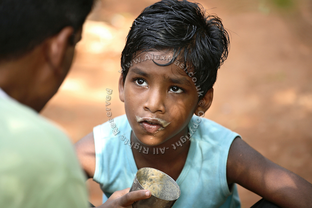 Budhia Singh, (left) 6, the famous Limca World Record marathoner, is portrayed while having breakfast and chatting with his neighbour in his home in Salia Sahi slum (pop. 30.000) of Bhubaneswar, the capital of Orissa State, on Sunday, May 18. On May 1, 2006, Budhia completed a record breaking 65 km run from Jagannath temple, Puri to Bhubaneswar. He was accompanied by his coach Biranchi Das and by the Central Reserve Police Force (CRPF). On 8th May 2006, a Government statement had ordered that he stopped running. The announcement came after doctors found the boy had high blood pressure and cardiological stress. As of 13th August 2007 Budhia's coach Biranchi Das was arrested by Indian police on suspicion of torture. Singh has accused his coach of beating him and withholding food. Das says Singh's family are making up charges as a result of a few petty rows. On April 13, Biranchi Das was shot dead in Bhubaneswar, in what is believed to be an event unconnected with Budhia, although the police is investigating the case and has made an arrest, a local goon named Raja Archary, which is now in police custody. **Italy and China Out**