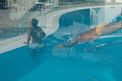 double exposure of a man diving in a swimming pool and getting out of the swimming pool