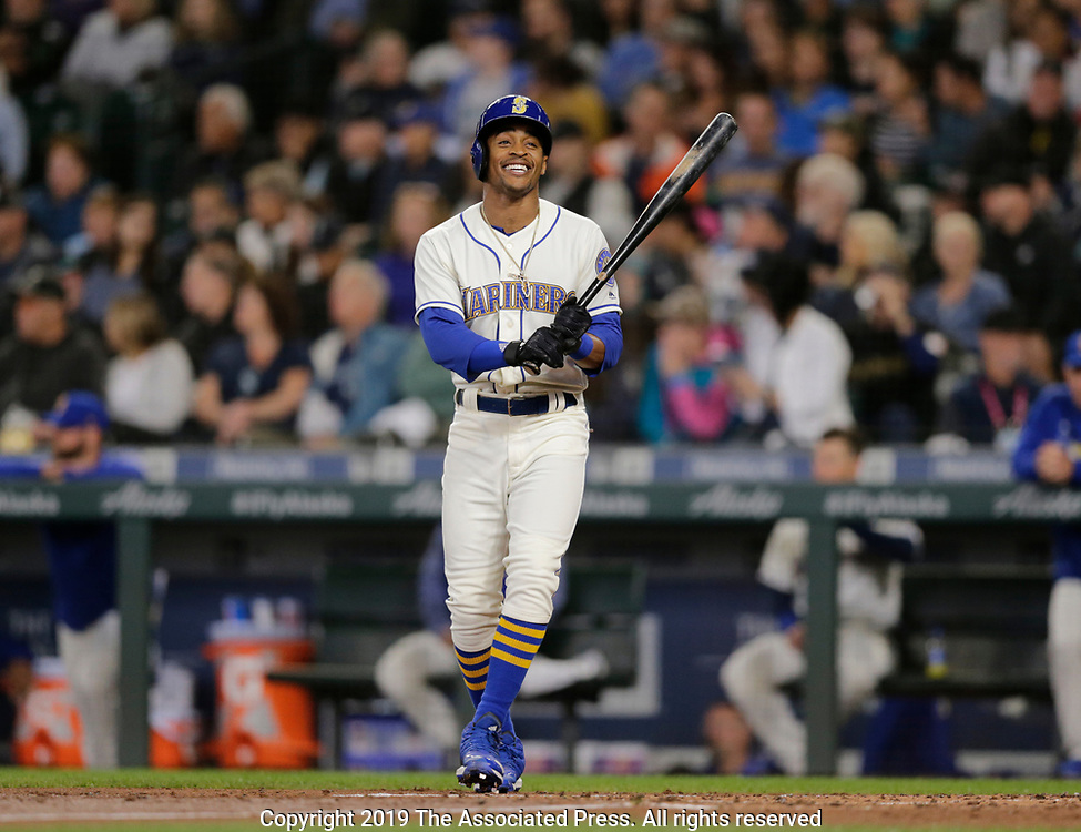 Seattle Mariners' Mallex Smith smiles as he walks to the batters box against the Chicago White Sox during a baseball game, Sunday, Sept. 15, 2019, in Seattle. (AP Photo/John Froschauer)