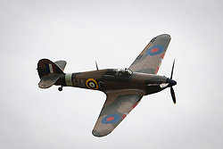 ©  London News Pictures. 18/10/2012. Duxford UK. The plane in flight. Photo call at Imperial War Museums Duxford in Cambridgeshire for a Hurricane fighter aircraft which is due to be auctioned off by Bonhams with an estimate of 1.4 million - 1.7 million pound sterling as part of a sale of Collectors' Motor Cars and Automobilia on Monday 3rd December. The Hurricane, the Royal Air Force's first monoplane fighter, had its finest hour during The Battle Of Britain when it shot down more enemy aircraft than its famous service partner the Spitfire.  Photo credit : Ben Cawthra/LNP