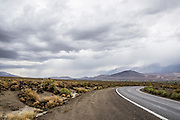 Storm clouds threaten with showers over the Eastern Sierras at Big Pine, Owens Valley, California, USA.