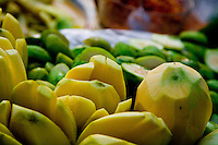 green mangoes peeled and cut sit ready for sale on the streets of Saigon