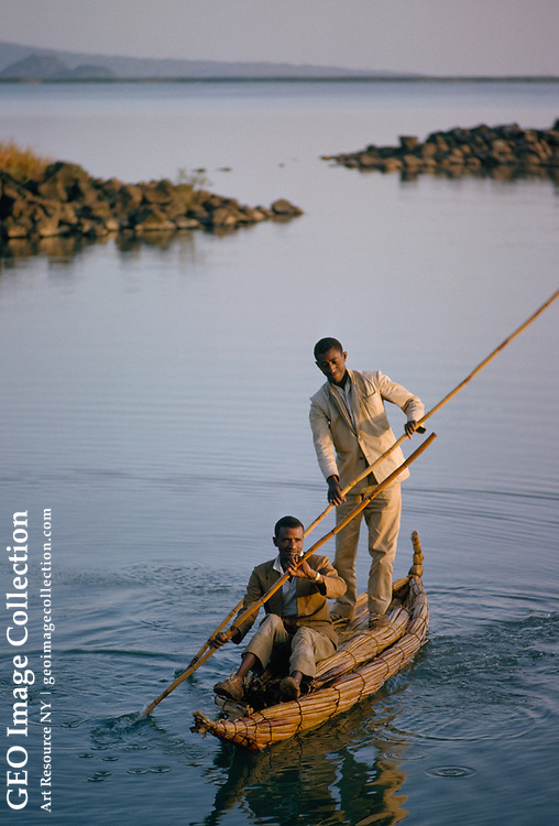 Two men paddle a papyrus boat, which must be dried often.