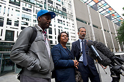 """© London News Pictures. 27/06/2013. London, UK. L to R - STUART LAWRENCE, DOREEN LAWRENCE and Lawyer IMRAN KHAN speaking to media outside the Home Office in London after meeting with Home Secretary Theresa May for talks following claims police tried to """"smear"""" the family in the wake of the 1993 murder of Stephen Lawrence. Photo credit: Ben Cawthra/LNP"""