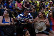 Colombian football fans living in London watch their team's eventual 4-3 loss (after penalties) with England in the knock-out stage of the World Cup at Elephant and Castle, on 3rd July 2018, in London, England. 15,000 Colombians have established a thriving community in London, many in the south London borough of Southwark, as well as other south American expatriates.