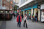 People out and about shopping in central Birmingham, United Kingdom.