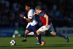 England's Xavier Amaechi (left) and Norway's Harald Martin Hauso battle for the ball during the UEFA European U17 Championship quarter final match at the Pirelli Stadium, Burton.