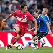 Turkey's Mehmet TOPAL (L) during their a international friendly soccer match Turkey betwen Estonia at TT Arena Istanbul August 10, 2011. Photo by TURKPIX