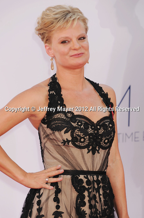 LOS ANGELES, CA - SEPTEMBER 23: Martha Plimpton  arrives at the 64th Primetime Emmy Awards at Nokia Theatre L.A. Live on September 23, 2012 in Los Angeles, California.