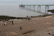 Beachcombers look for finds at Clevedon Pier, on 27th December 2018, in Clevedon, North Somerset, UK.