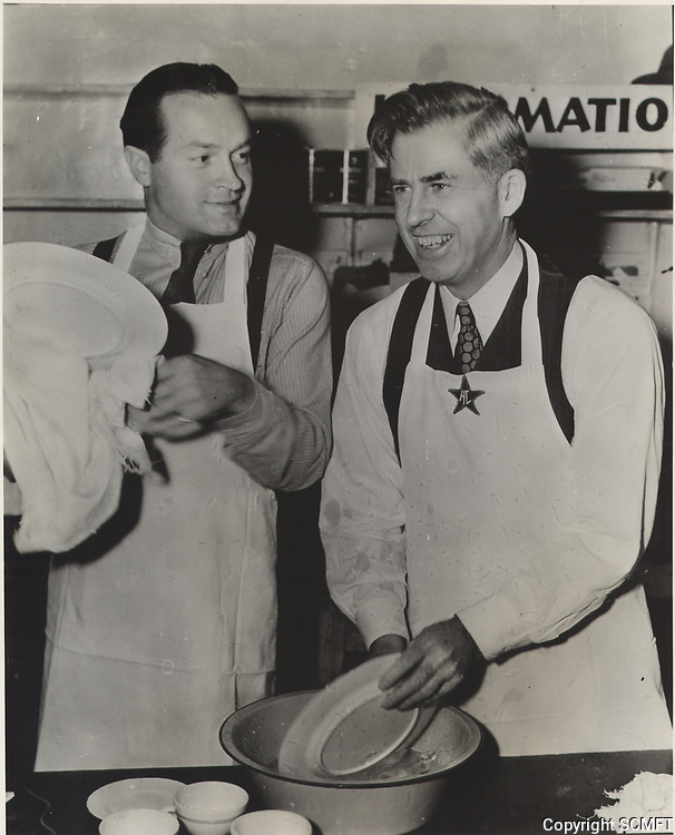 1944 Bob Hope and U.S. Vice President, Henry Wallace wash dishes in the kitchen at the Hollywood Canteen