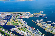 Nederland, Noord-Holland, Den Helder, 05-08-2014; centrum van Den Helder met links rijkswerf Willemsoord (Oude Rijkswerf), nu deels in gebruik als jachthaven. Veerhaven voor de veerboten naar Texel.<br /> Center of Den Helder with former Navy Yard Willemsoord (Old Navy Yard), now partly used as a marina. Ferry port for ferries to Texel. <br /> luchtfoto (toeslag op standard tarieven);<br /> aerial photo (additional fee required);<br /> copyright foto/photo Siebe Swart