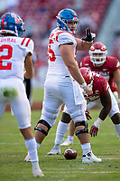 FAYETTEVILLE, AR - OCTOBER 17:    Ben Brown #55 signals back to Matt Corral #2 of the Mississippi Rebels during a game against the Arkansas Razorbacks at Razorback Stadium on October 17, 2020 in Fayetteville, Arkansas.  The Razorbacks defeated the Rebels 33-21.  (Photo by Wesley Hitt/Getty Images) *** Local Caption *** Matt Corral; Ben Brown