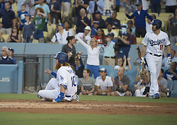 August 11, 2017 - Los Angeles, California, U.S - 11 Aug 2017. The Los Angeles Dodgers play the San Diego Padres in the first  game of a three-game series at Dodger Stadium. Pictured is Dodger Justin Turner after scoring a run. (Credit Image: © Prensa Internacional via ZUMA Wire)