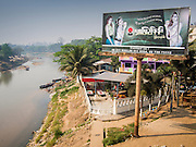 02 MARCH 2014 - MYAWADDY, KAYIN, MYANMAR (BURMA):   A billboard for Burmese beauty creams in Myawaddy on the Burmese side of the Moie River on the Thai-Burma border. Myawaddy is separated from the Thai border town of Mae Sot by the Moei River. Myawaddy is the most important trading point between Myanmar and Thailand.   PHOTO BY JACK KURTZ