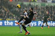 Manchester city's Alvaro Negredo is stopped by Swansea city's Chico Flores. Barclays Premier league, Swansea city v Manchester City at the Liberty Stadium in Swansea,  South Wales on  New years day Wed 1st Jan 2014 <br /> pic by Andrew Orchard, Andrew Orchard sports photography.