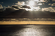 Sunset over the water looking at Dungeness nuclear power plant. Folesktone Kent.
