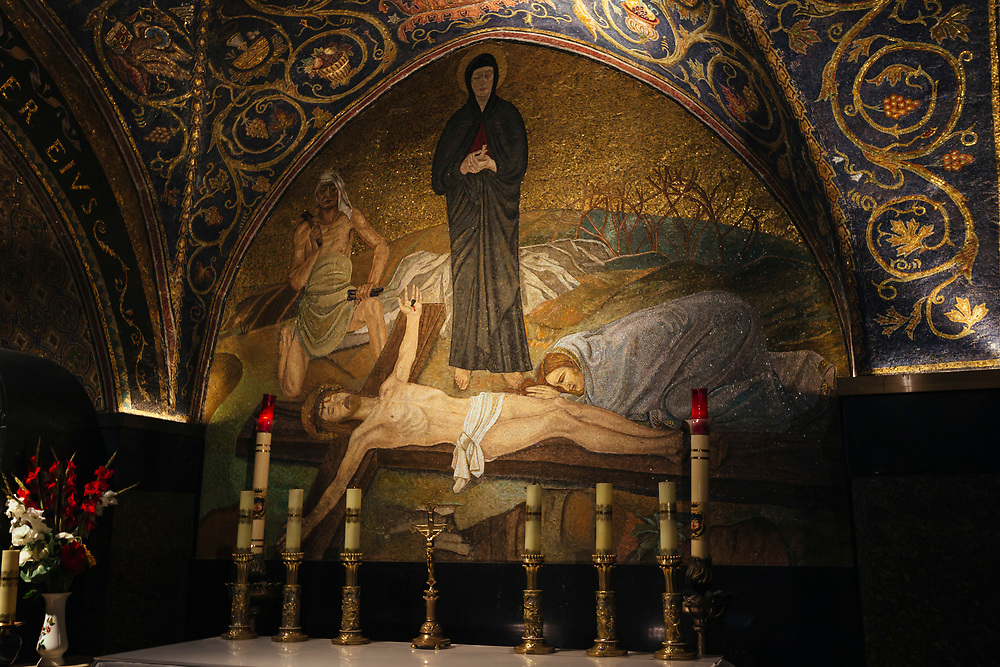 A mosaic depicting the crucifixion of Jesus is seen at the Golgotha, or Calvary, the traditional site where Jesus was crucified, in the Church of the Holy Sepulchre, traditionally believed by many Christians to be the site of the crucifixion, burial and resurrection of Jesus Christ, in the Old City of Jerusalem, Israel, on March 4, 2019.