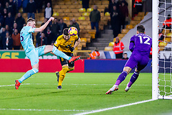 February 11, 2019 - Wolverhampton, England, United Kingdom - Matt Doherty of Wolverhampton Wanderers goes in with the head for a low ball against Sean Longstaff of Newcastle United  during the Premier League match between Wolverhampton Wanderers and Newcastle United at Molineux, Wolverhampton on Monday 11th February 2019. (Credit Image: © Mi News/NurPhoto via ZUMA Press)