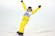SHOT 1/25/08 8:32:18 PM - Snowboarder Gretchen Bleiler of Aspen, Co. raises her arms in victory after making her way down the superpipe during the Snowboard Superpipe Finals Friday January 25, 2008 at Winter X Games Twelve in Aspen, Co. at Buttermilk Mountain. Bleiler, a hometown favorite, won the event with a score of 93.33. The 12th annual winter action sports competition features athletes from across the globe competing for medals and prize money is skiing, snowboarding and snowmobile. Numerous events were broadcast live and seen in more than 120 countries. The event will remain in Aspen, Co. through 2010. Gretchen aspired to compete in the Olympic Games from a very young age, and found her passion in snowboarding at age 11 (1992). She has been riding ever since, became professional in 1996 and is currently recognized as a role model and pioneer in the sport. Among her accomplishments, Gretchen jump-started the invert revolution for female riders as the first to land a Crippler 540 in competition, and won more halfpipe competitions in 2003, 2005 and 2006 than any other female snowboarder. In the pre Olympic season she won four of the five US Olympic halfpipe qualifiers and is also a three time X Games gold medalist, most recently winning the superpipe at Winter X Games XII..(Photo by Marc Piscotty / © 2008)
