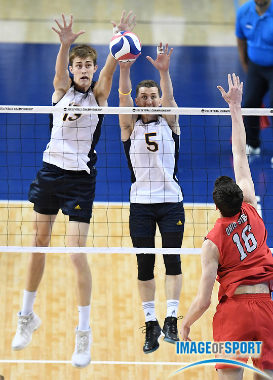 UC Irvine Anteaters middle blocker Scott Stadick (13) and outside hitter Tukcer Pikula (5) block a shot by Ohio State Buckeyes opposite hitter Jake Hanes (16) during the opening round game of the NCAA college volleyball championship in Los Angeles, Tuesday, May 1, 2018. Ohio State defeated UC Irvine 25-19, 22-25, 25-23, 22-25, 16-14.
