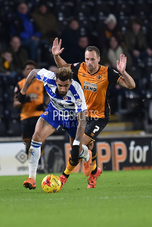 Daniel Williams Reading FC ,Hull City midfielder David Meyler  during the Sky Bet Championship match between Hull City and Reading at the KC Stadium, Kingston upon Hull, England on 16 December 2015. Photo by Ian Lyall.