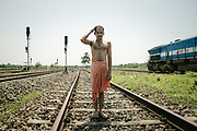 After the 85-hour train journey, a train employee enjoys a wash at the Dibrugarh station.<br /> Outside the Dibrugarh-Kanyakumari Vivek Express, the longest train route in the Indian Subcontinent. It joins Kanyakumari, Tamil Nadu, which is the southernmost tip of mainland India to Dibrugarh in Assam province, near the border with Burma.