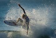 A surfer on at Huntington Beach, Ca, Thursday, November 6, 2014. (Photo: Bryan Woolston / @woolstonphoto)