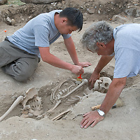 Smithsonian archaeologist & forensics specialist, Dr. Bruno Frohlich, & Amgalantugs Tsend, a Mongolian archaeology student, unearth a bronze-age skeleton at a site above the Delger River near Muren, Mongolia. The  skeleton may be 2700+ years old.
