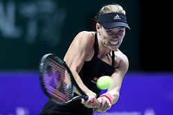 October 22, 2018 - Singapore, Singapore - Angelique Kerber of Germany returns a shot during the match between Angelique Kerber and Kiki Bertens on day 2 of the WTA Finals at the Singapore Indoor Stadium. (Credit Image: © Paul Miller/ZUMA Wire)