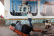 A cycle rickshaw driver is taking a break on the streets of Agra. The Taj Mahal has been struggling to keep in shape also because of the high levels of pollution in the city, mainly caused by congested roads and high levels of traffic, vehicles and an increasing population, in Agra.