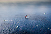 """Deepwater offshore oil platform """"DELTA HOUSE"""" being positioned offshore in the Gulf of Mexico by Crowley Maritime Corporation's OCEAN CLASS Tugs. (Aerial Photography by Tim Burdick)"""