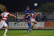 AFC Wimbledon striker Kweshi Appiah (9) with a header on goal during the The FA Cup match between AFC Wimbledon and Doncaster Rovers at the Cherry Red Records Stadium, Kingston, England on 9 November 2019.