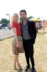 PORTIA FREEMAN and PETE DENTON at the Veuve Clicquot Gold Cup, Cowdray Park, Midhurst, West Sussex on 21st July 2013.