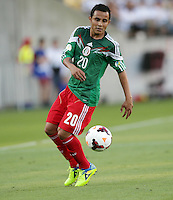 Mexico's Luis Montes against New Zealand in the World Cup Football qualifier, Westpac Stadium, Wellington, New Zealand, Wednesday, November 20, 2013.