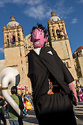 A traditional Mojigangas, Giant paper-mache puppet, performs in front of the Santo Domingo Church during the Day of the Dead Festival known in spanish as Día de Muertos on October 25, 2014 in Oaxaca, Mexico.