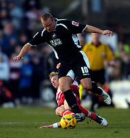 Photo: Jed Wee.<br />Doncaster Rovers v Swansea City. Coca Cola League 1.<br />17/12/2005.<br />Swansea's Lee Trundle (R) is tackled by Doncaster's Ricky Ravenhill.