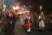"""French Marianne<br /><br />Lewes Bonfire, describes a set of celebrations held in the town of Lewes, Sussex that constitute the United Kingdom's largest and most famous Bonfire Night festivities. Held on 5 November, the event not only marks Guy Fawkes Night - the date of the uncovering of the Gunpowder Plot in 1605 - but also commemorates the memory of the seventeen Protestant martyrs from the town burned at the stake for their faith during the Marian Persecutions. Lewes is home to the largest and most celebrated of the festivities in the Sussex bonfire tradition. There are seven societies putting on six separate parades and firework displays throughout Lewes on November the 5th. As well as this, 25-30 societies from all around Sussex come to Lewes on the fifth to march the streets. There is a history of religious antagonism and anti-popery around the bonfire celebrations in Lewes. A number of large effigies are drawn through the streets before being burned at the bonfires, these """"Enemies of Bonfire"""" range from nationally reviled figures to local officials."""