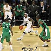 Central Florida guard Marcus Jordan (5) dribbles  toward Marshall forward Tirrell Baines (30) during a Conference USA NCAA basketball game between the Marshall Thundering Herd and the Central Florida Knights at the UCF Arena on January 5, 2011 in Orlando, Florida. Central Florida won the game 65-58 and extended their record to 14-0.  (AP Photo/Alex Menendez)