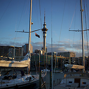 Moored yachts in Viaduct Basin. Auckland, New Zealand, .Located in the heart of Auckland City, Viaduct Basin and Harbour is a first class residential, commercial and entertainment precinct..The marina caters to commercial vessels, pleasure craft and super yachts with 150 marina berths ranging in size up to 60 metres..Viaduct Basin hosts many fabulous events including the past America's Cup defences, Louis Vuitton Regattas, the Volvo Round the World Race stopover, Auckland International Boatshow and New Zealand Fashion Week..Visitors can explore New Zealand's rich maritime history at Voyager Maritime Museum, cruise the harbour on a charter yacht, view the yachts berthed in the harbour and enjoy the world class hospitality at the many bars and restaurants that line the waters edge..New Zealand's largest marine service precinct, Westhaven, lies a short walk to the west.. Auckland, New Zealand. 3rd November 2010. Photo Tim Clayton.