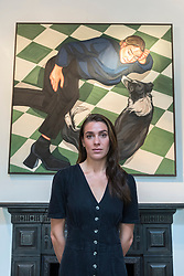 """© Licensed to London News Pictures. 04/09/2020. LONDON, UK. Ania Hobson (with """"The Chequered Floor"""") at the preview of her new exhibition at Hampstead's Catto Gallery. In her debut solo London show, the former winner of the BP Portrait Young Artist Award is exhibiting her newest set of paintings which celebrate modern women, 5 to 23 September.  Photo credit: Stephen Chung/LNP"""