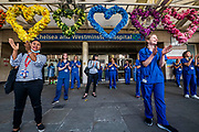 Hospital staff come out of Chelsea and Westminster and are greeted by a small but enthusiastic crowd, as this was probably the last time - Clap for carers, to say thanks to NHS and other key workers and carers. The 'lockdown' continues in London - Coronavirus (Covid 19) outbreak in London.