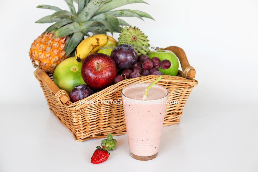 Fruit Health drink with a basket of fresh fruit on white background